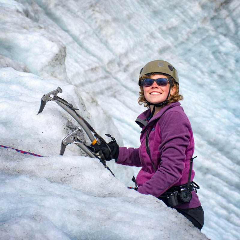 High school students ice climbing on summer community service program in Alaska.